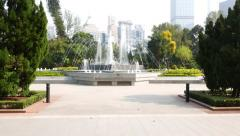 POV walk to fountain at Hong Kong Zoological and Botanical Gardens square Stock Footage