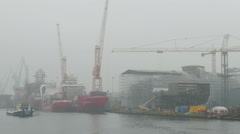 Stock Video Footage of Shipyard. Ship is waiting for a ceremonial ship launching in a foggy day