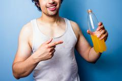 Young man drinking energy drink after a sweaty workout Stock Photos