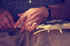 Close up of female hands weaving basket Stock Photos