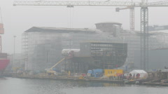 Section of ship during construction at shipyard. Close up. Foggy day Stock Footage