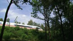 German ICE high-speed train across elevated railway embankment - low angl Stock Footage