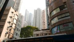 Variety of buildings, different look and age, narrow tall towers at background Stock Footage