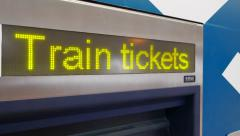 Train tickets kiosk display close up, english change to chinese characters Stock Footage