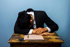 Businessman sleeping after closing important deal - stock photo