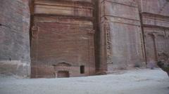 Camels walking along road in Petra, Jordan Stock Footage