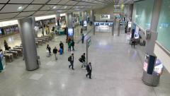 People come through express train station hall, arrive from airport Stock Footage