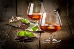 Vintage cognac still life with chocolate - stock photo