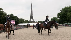 horses Tournament in Paris in back the Eiffel tower - stock footage