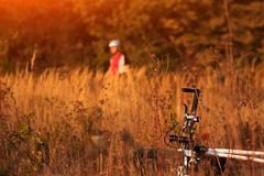 cyclist with bike relax in the sunny autumn park - stock photo