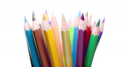 Top of color pencils turning on a white background Stock Footage