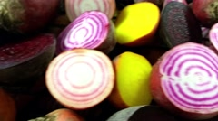 Candy stripe, purple and golden beetroot halves, inside a smoker box - stock footage