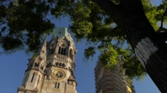 Tilt down the spire of the Kaiser Wilhelm Church Stock Footage