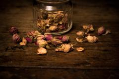 Close up on dried rosebuds - stock photo