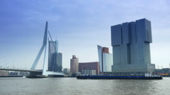 The Erasmusbrug and modern buildings of Rotterdam Stock Footage