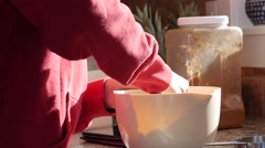 A mother mixing butter and flour to bake a pie Stock Footage