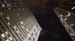 Highrise buildings and dark evening sky with floating white clouds. Stock Footage