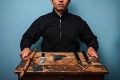 Gangster with various weapons - stock photo