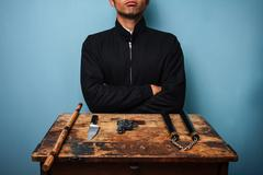 Dangerous man with various weapons - stock photo