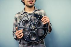 Hipster with old 35mm film reel Stock Photos