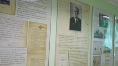 Documents and photographs on the wall in the hall of Hospital Stock Footage