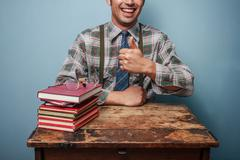 Geek man giving thumbs up - stock photo