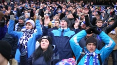 Dinamo soccer team fans rhythmically applaud and yell on grandstand Stock Footage