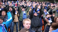 Dinamo soccer team fans yell and rhythmically applaud on grandstand Stock Footage