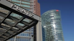 Tilt down from S-Bahn sign to Potsdamer Platz - stock footage