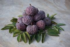 Thai native sweet fruit in purple custard apple Stock Photos