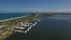 Aerial video along Haulover Marina, Miami. Backward and down movement. 4k. - stock footage