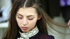 Face of girl model whose hair makeup artist goffers. - stock footage
