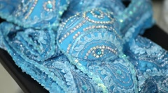 Blue female costume with white ornaments lies on chair. Stock Footage
