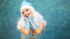 girl model dressed in costume of Snow Maiden poses clasping face - stock footage