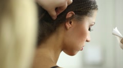 Visagiste uses hair spray during she makes hairdo to model. Stock Footage