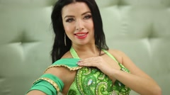 Young girl model in oriental style green costume poses. Stock Footage