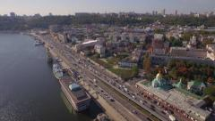 Aerial view on a traffic jam on the embankment of big river Stock Footage
