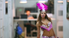 Girl dressed in exotic carnival costume with feather plume dances Stock Footage