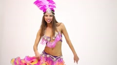 Girl dressed in exotic costume dances spinning and shaking hips Stock Footage
