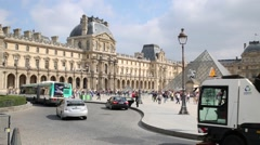 Car traffic at Court of Napoleon with pyramid in Louvre museum. Stock Footage