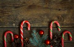 Christmas border with fir tree branches, cones, christmas decorations and can - stock photo