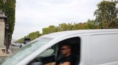 Stream of cars crosses crossroad against the Place de la Concorde Stock Footage