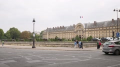 Car traffic on crossroad against Hotel national des Invalides Stock Footage