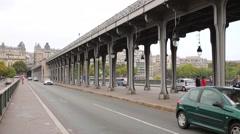 Transport traffic and people on Bir Hakeim bridge and vessels. Stock Footage
