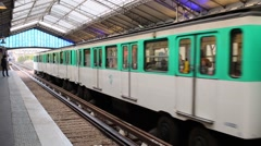 Subway train leaves Bir Hakeim station in Paris. Stock Footage