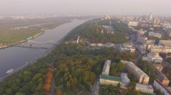 Aerial urban view. Flying near a big river - historic area of Kiev Stock Footage