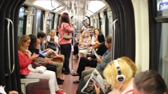 People in subway train car at Tuileries station. Stock Footage