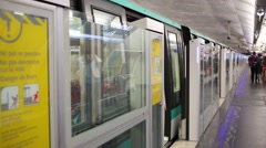 Subway train starts and leave Charles de Gaulle Etoile station. Stock Footage