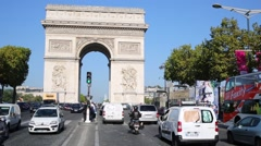 Car traffic and people on pedestrians island near Arch of Triumph - stock footage