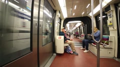 Children sit on seats of fast moving subway train car. Stock Footage